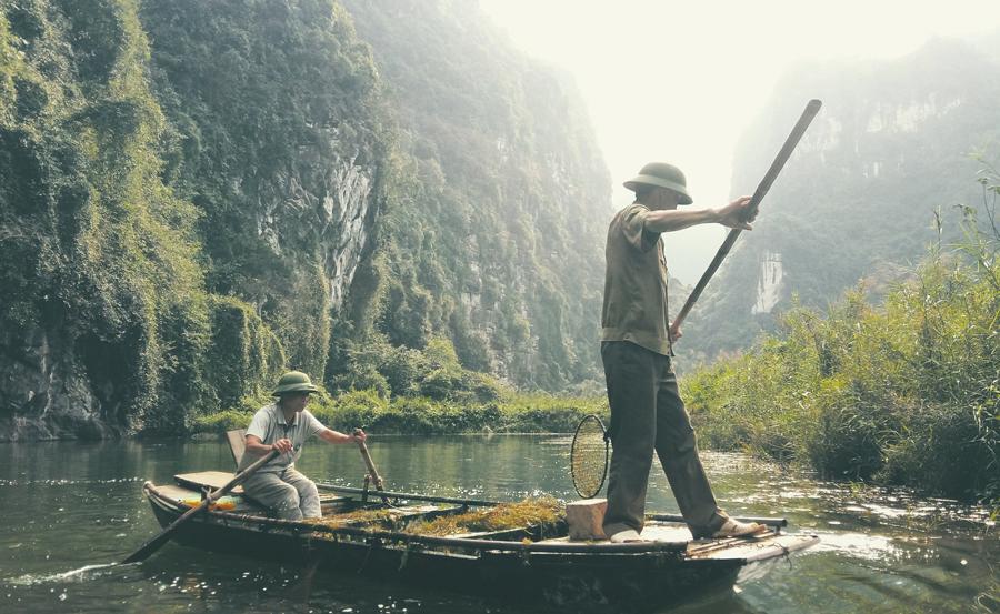 photo de pecheur sur l'eau, Asie du sud est